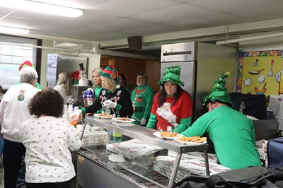 Sun Coke employees dressed as elves serve lunch at Vern Riffe School.