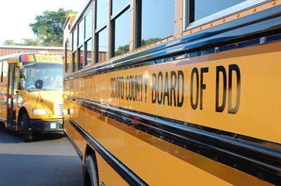 Scioto County Board of DD in black lettering on yellow school bus
