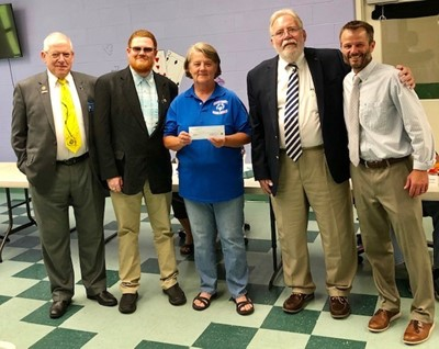 Four men and one woman at donation presentation to Scioto County Special Olympics by Aurora Lodge members