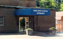 Vern Riffe School's main entrance is located on the parking lot behind the building.  The blue a